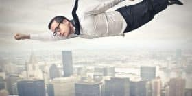 Man in glasses and suit flying over city - Ayn Rand quotes about hero and soul - Inspirational Writing Quotes