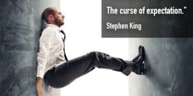 Man propping himself up between walls - Stephen King quotes about curse and expectation - Stephen King Quotes On Writing