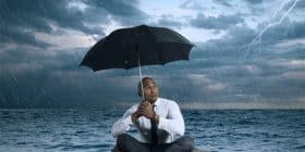 Man floating on cushion in storm, holding umbrella - William Faulkner quotes about dream and perfection - Faulkner Quotes On Writing